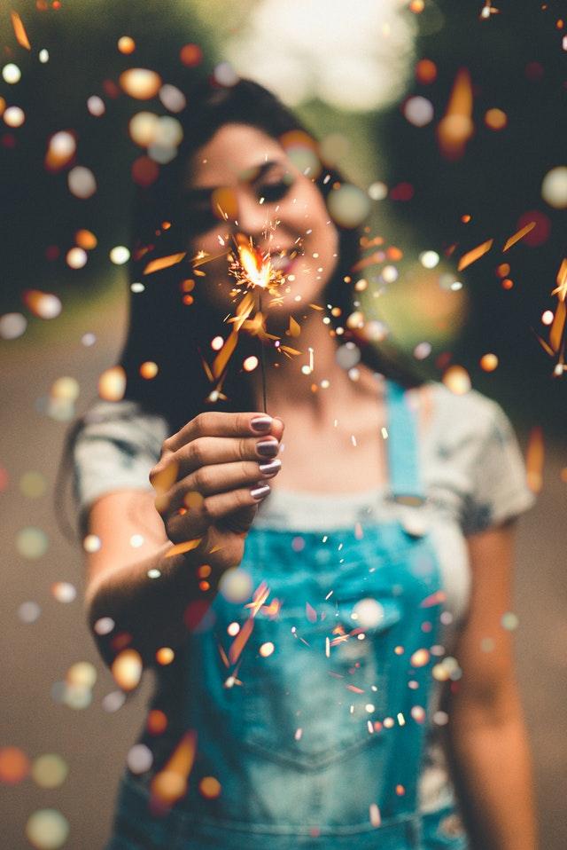 girl-holding-sparkler-new-years-eve.jpeg
