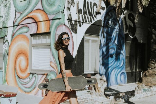 Woman with skateboard and graffiti background.jpeg
