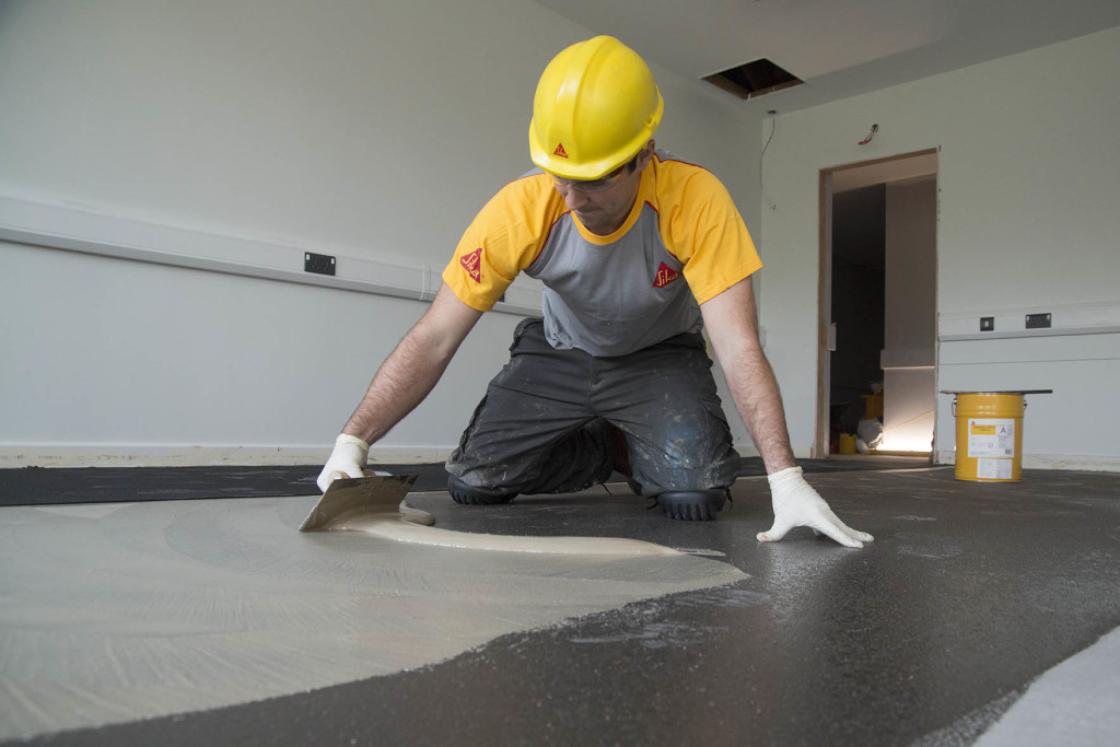Installing commercial flooring from Sika.Photo courtesy  PSS Magazine .