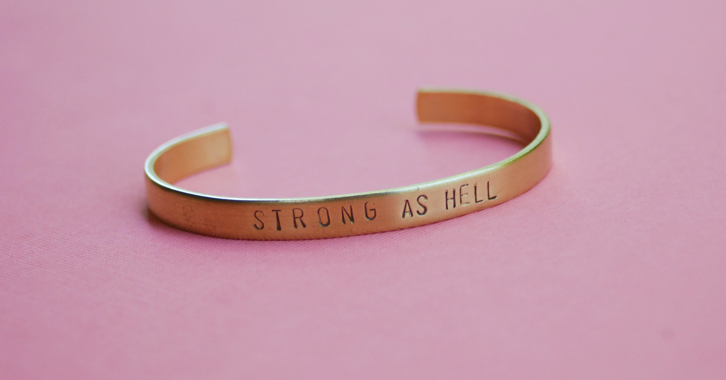 Strong as Hell Bracelet by Arkansas handmade jewelry designer Bang-Up Betty to benefit Arkansas Womens' Outreach in Little Rock.
