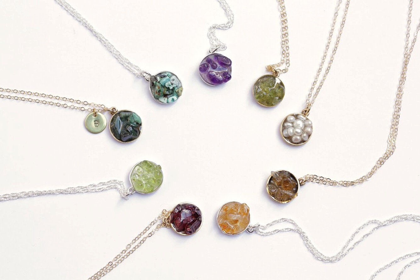 "Our original  Birthstone Cluster Necklaces  feature birthstones set into cluster pendants and are customizable with stamped discs that fit up to three letters. Monograms, the word ""mom"" and a heart shape fit perfectly. Photo by Collin Buchanan."