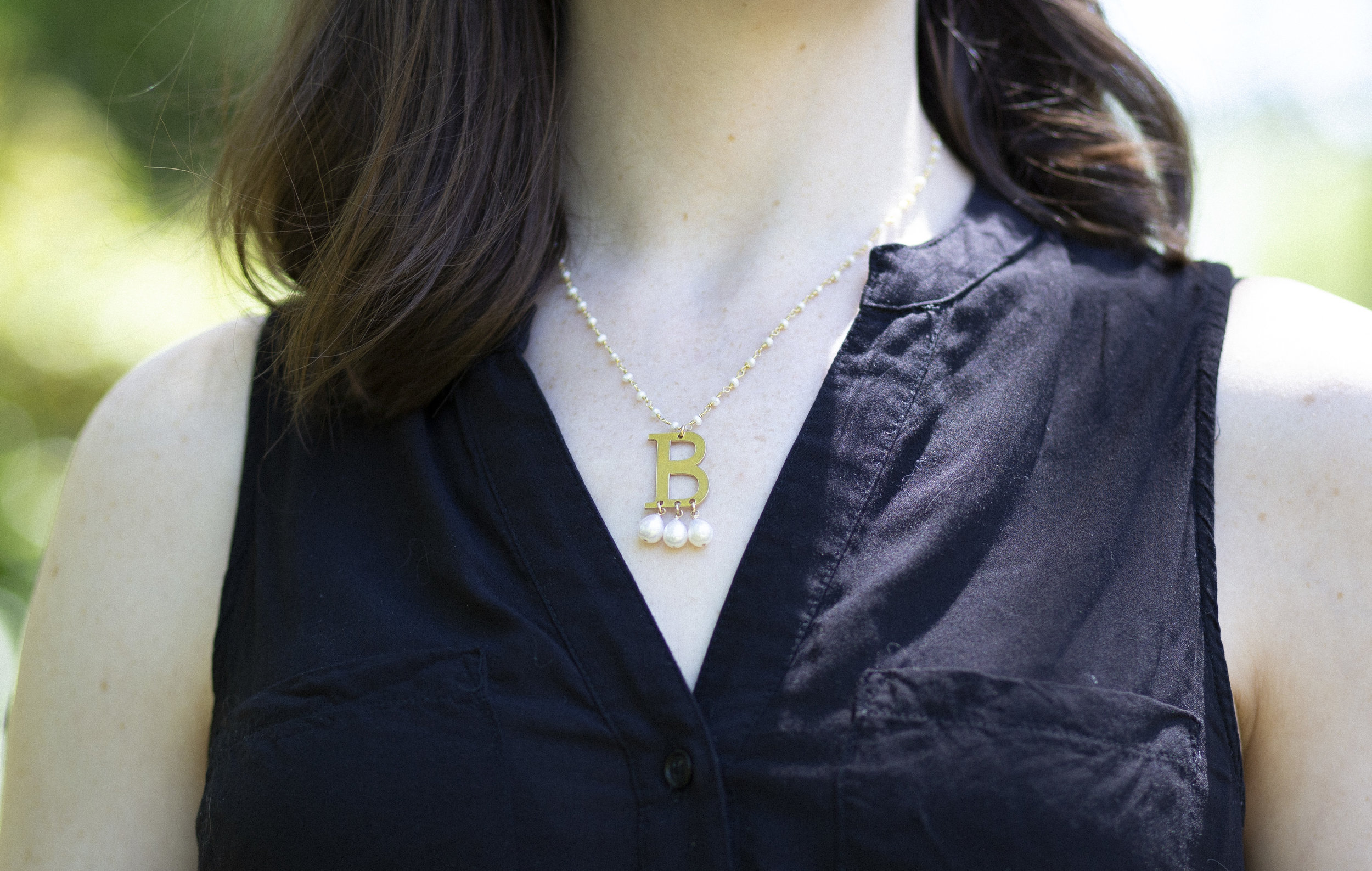 My monogram just happens to be the same as Anne Boleyn's, but you can wear your own monogram in the  same style of necklace . Photo by Collin Buchanan.