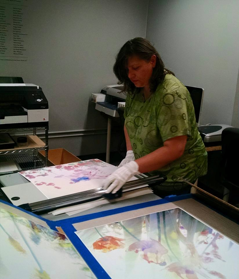 Printing and trimmingphotos at the Photographic Center Northwest, in their lovely air-conditioned facilty!