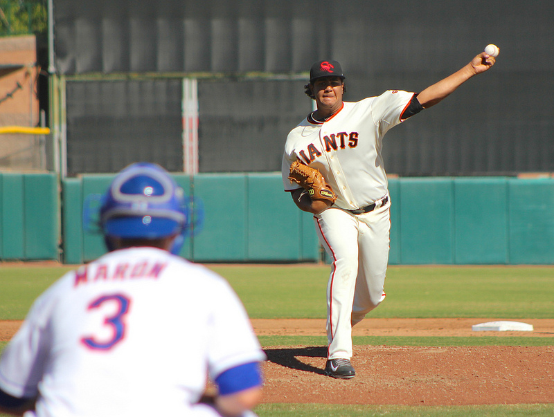 Adalberto Mejia throws warm-ups pitches before his first Fall League start. (Conner Penfold / Giant Potential)