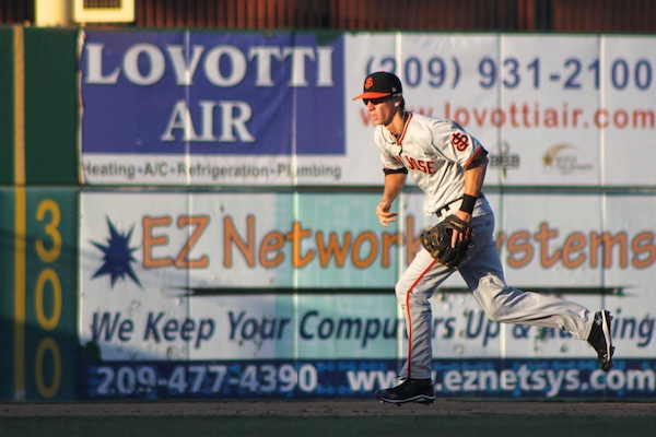 Matt Duffy fields a ground ball on Sunday night against the Stockton Ports. (Conner Penfold / Giant Potential)