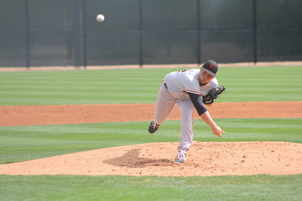 Right-hander Stephen Woods, selected in the 8th round of 2016's draft, throwing on Wednesday — day one of scheduled minor league spring training games against other teams. (Conner Penfold/Giant Potential)