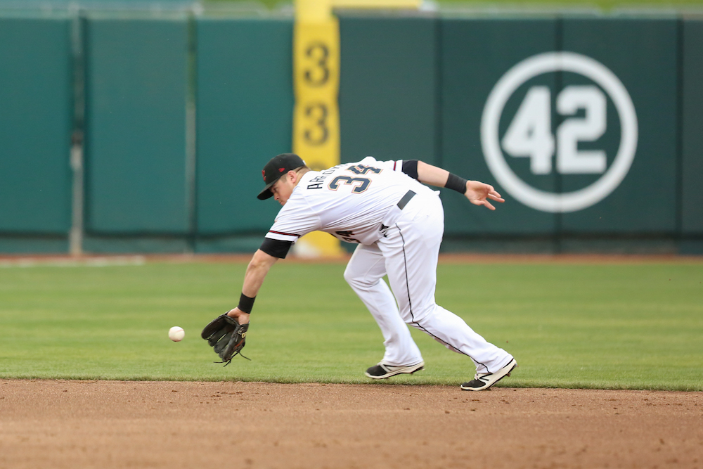 Christian Arroyo has been playing a mix of second base, third base, and shortstop in his first Triple-A stint. At the plate, he's recorded a hit in all 12 games. (Tim Cattera/MiLB.com)