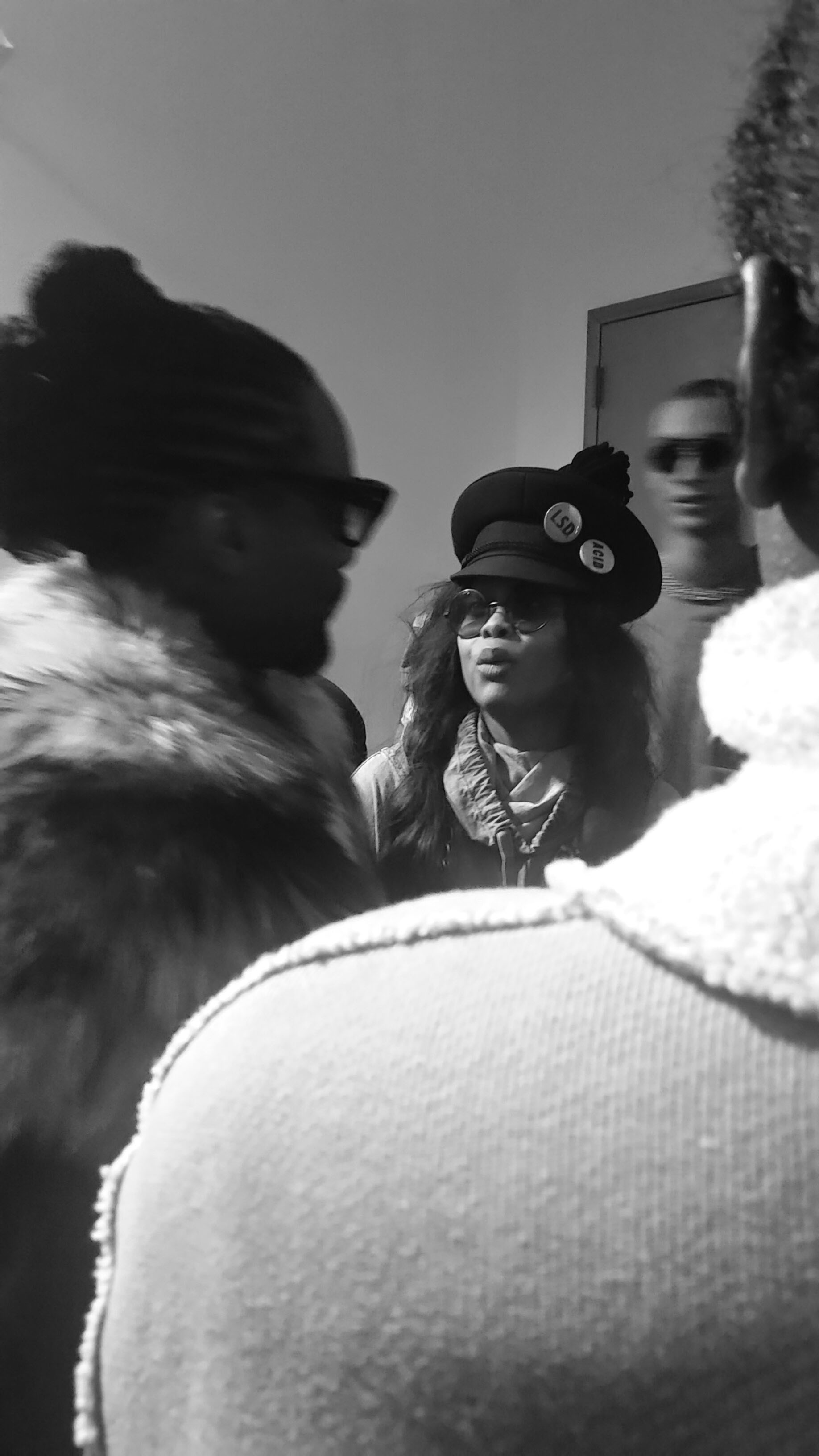 Erykah Badu talking to Wale backstage at the Pyer Moss AW16 show (credit: Kali Brown)