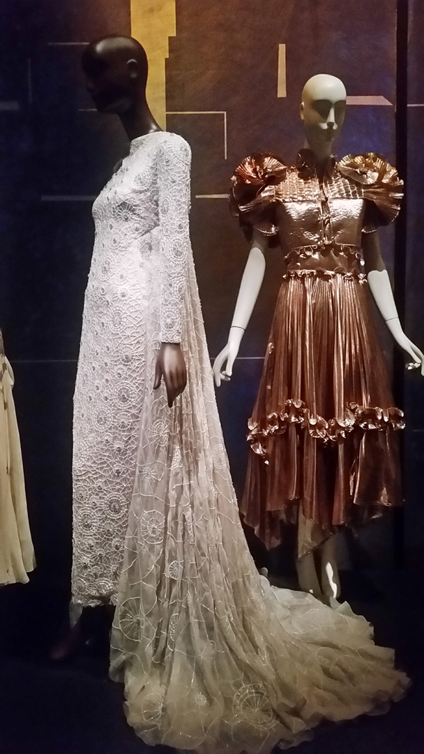 (l to r) Bibhu Mohapatra white evening gown; Zandra Rhodes gold dress