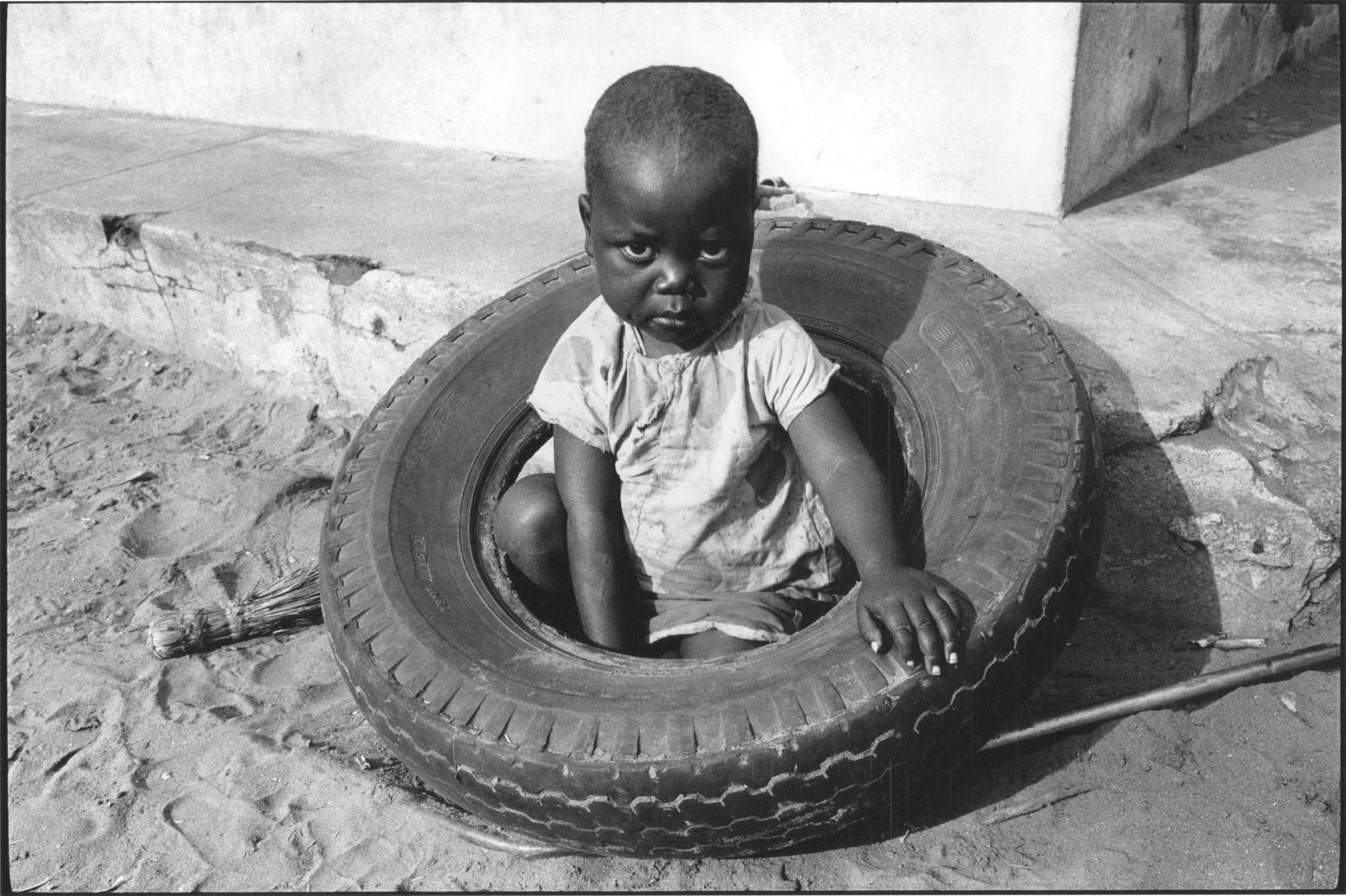 """Child, Mozambique, 1990"":  ""When I arrived in Mozambique it was not safe to leave the capital, Maputo. This photograph was made on the edge of town."""