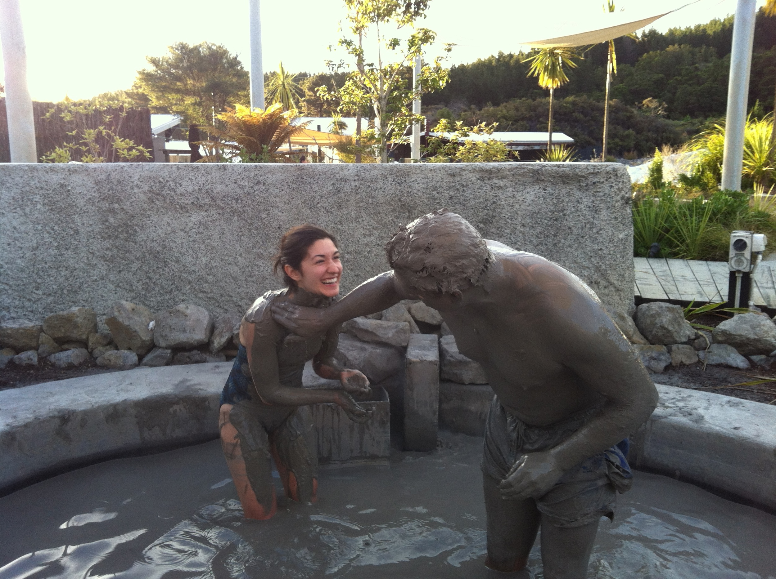 Joe painting Gabrielle with mud.