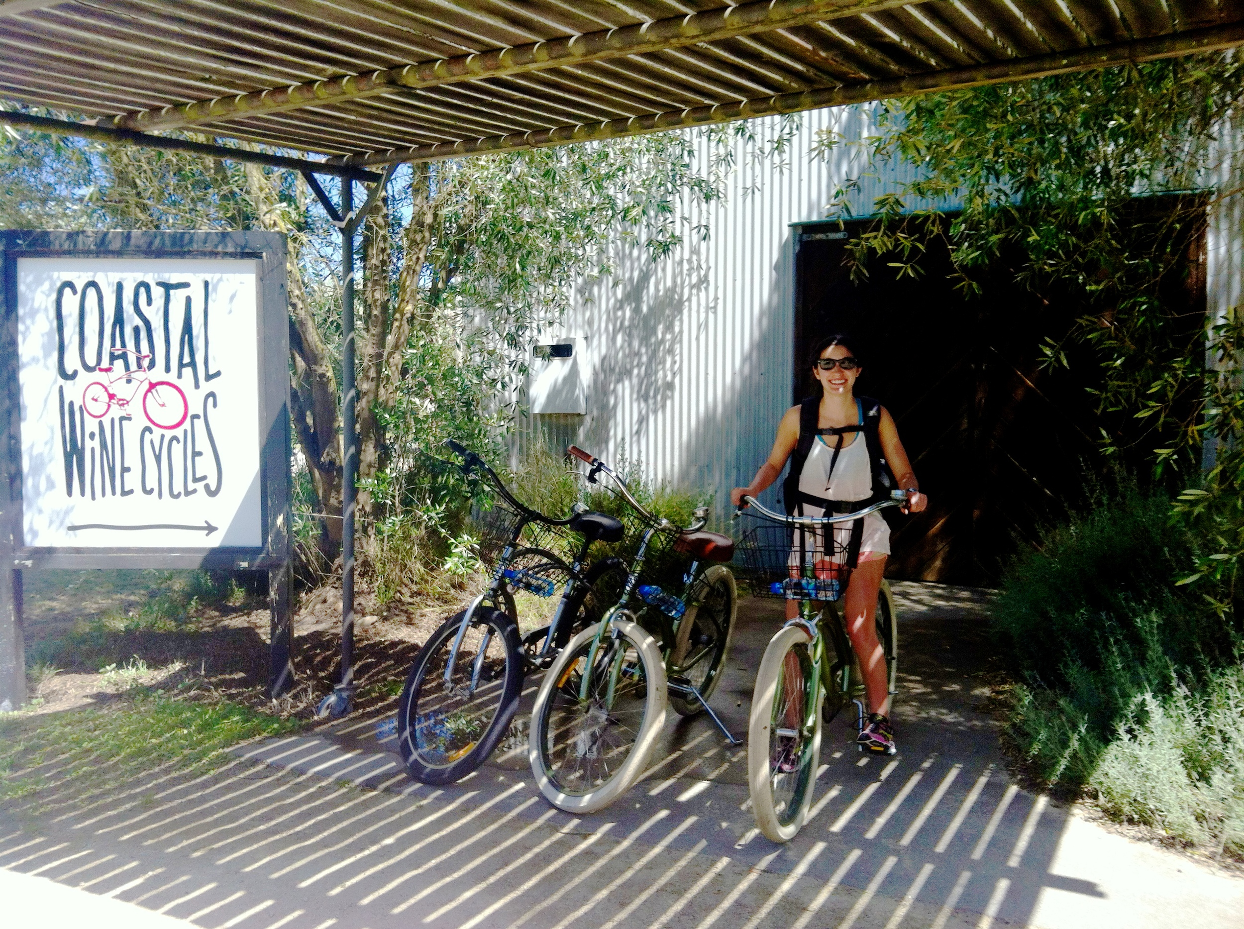 Collecting our bikes at Coastal Wine Cycles.