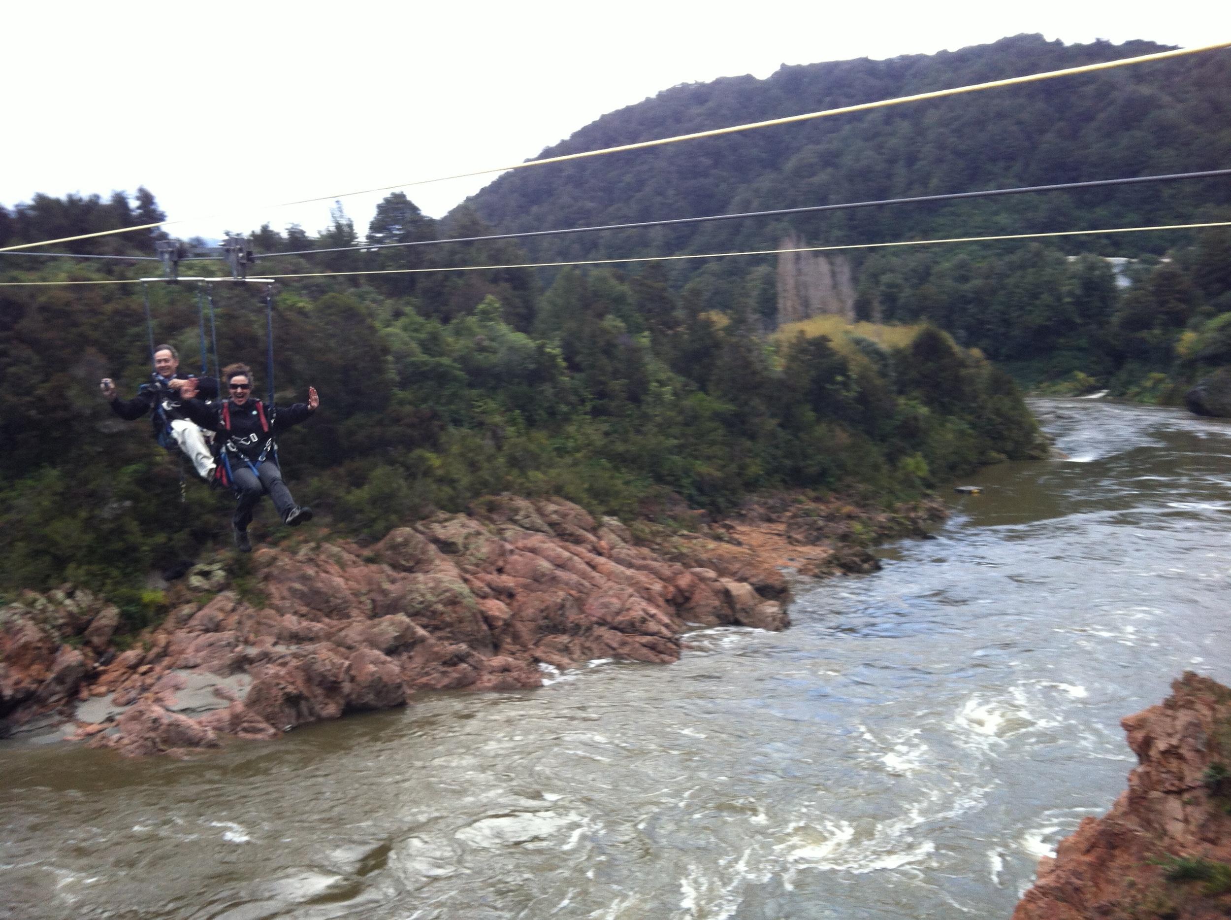 My parents zip lining across New Zealand's longest swing bridge.