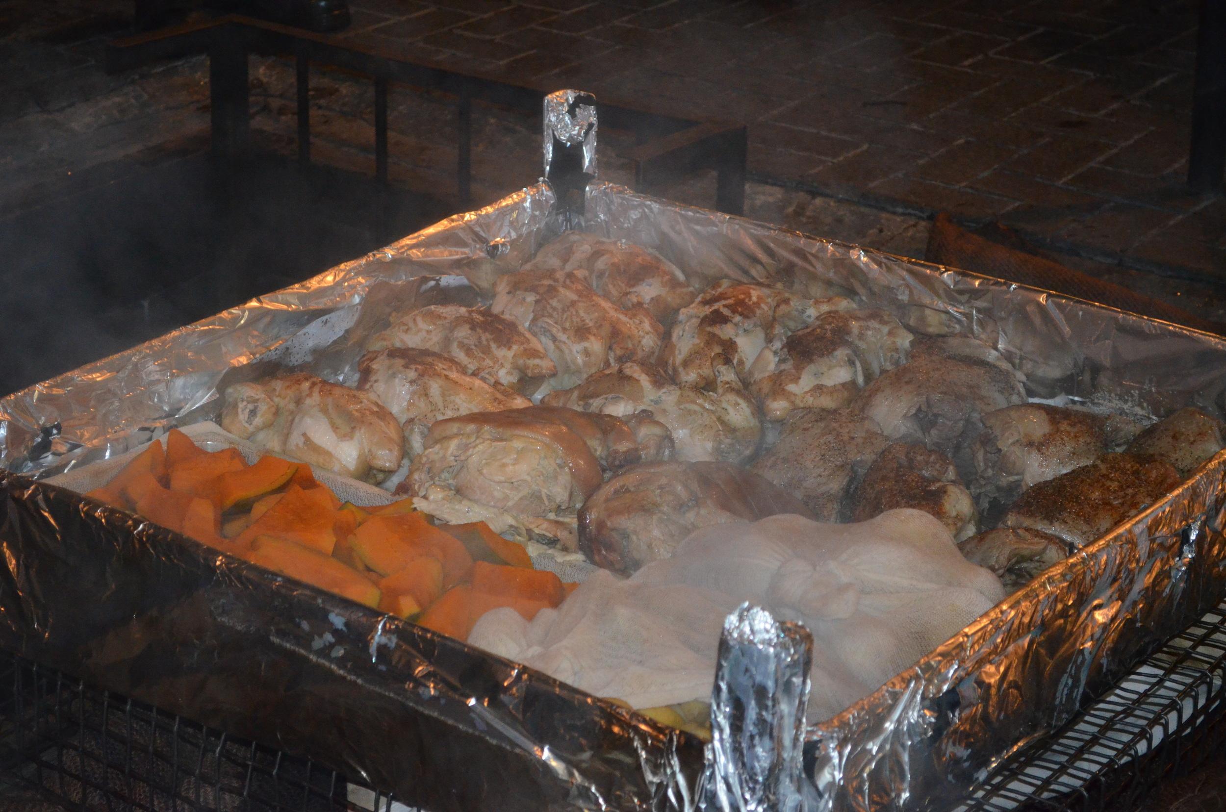 Pork, lamb, chicken, and kumera roasting in the pit. Kumera is one of my new favorite New Zealand! It's similar to a sweet potato.