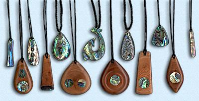 Traditional New Zealand jewelry using wordcarving and paua shells.  Source