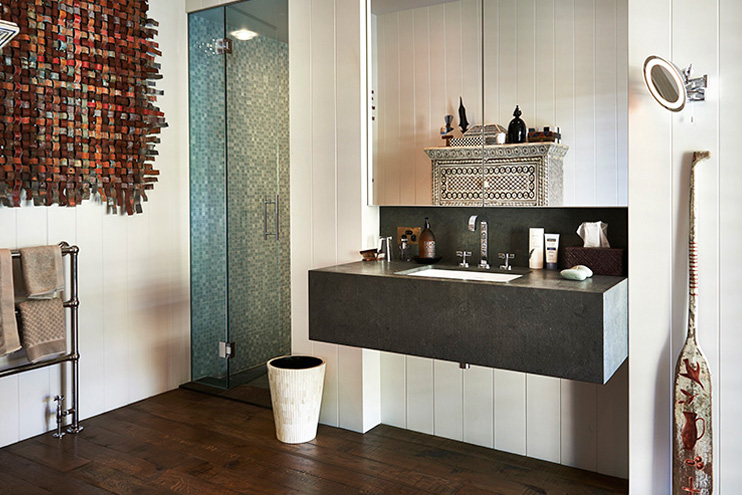 Notice all of the artwork and beautiful details even in the bathroom. I was dying for this chest of drawers which you can see reflected in the mirror.  Source