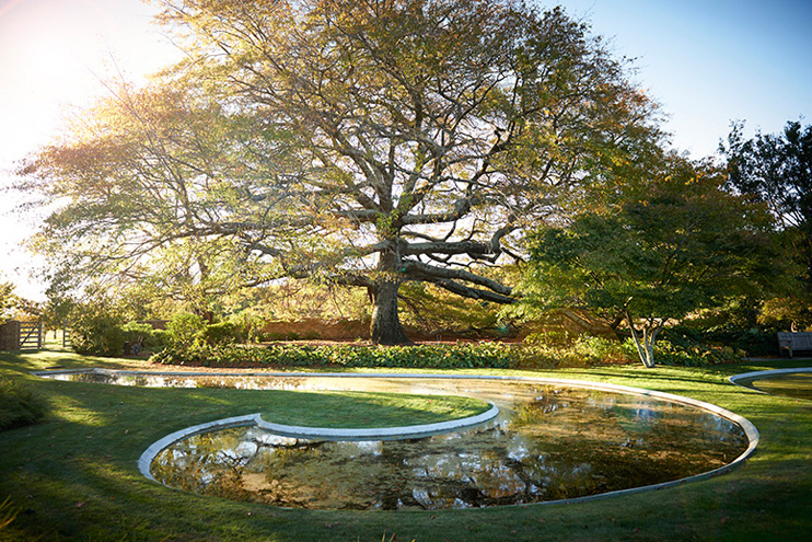 A bit of Maori influence in the garden with a fish hook-shaped pond.  Source