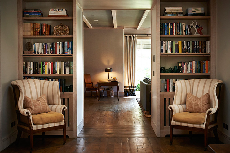 View looking into the great room from the foyer. How gorgeous are those wood floors?  Source