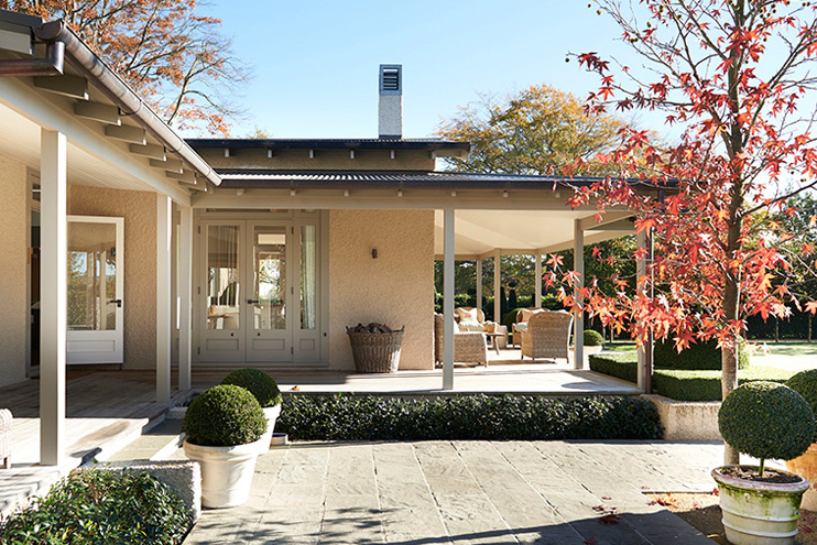 A view of the side patio which opens into the main living space.  Source
