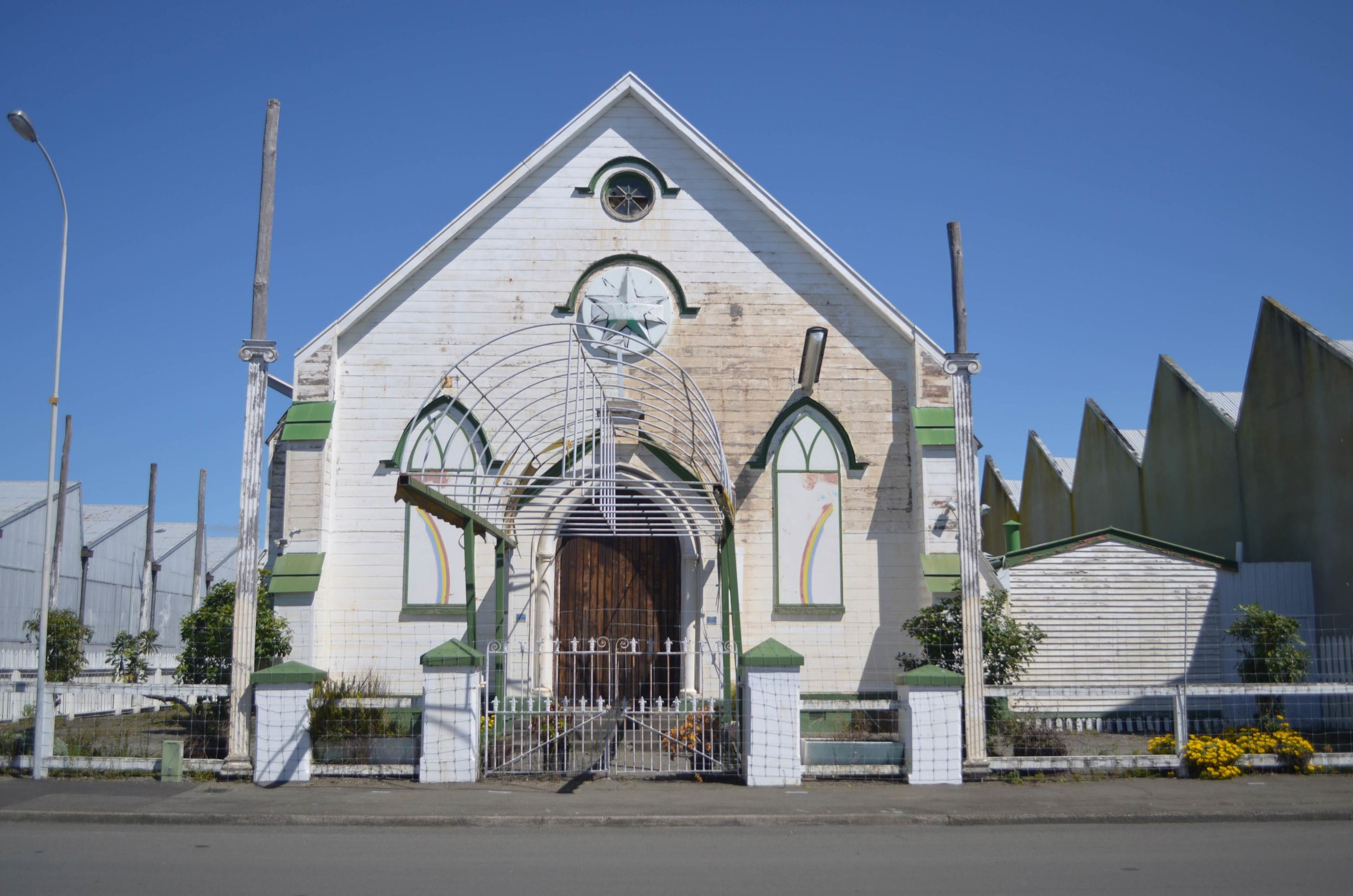 An abandoned church sandwiched between the wool stores in Ahuriri.