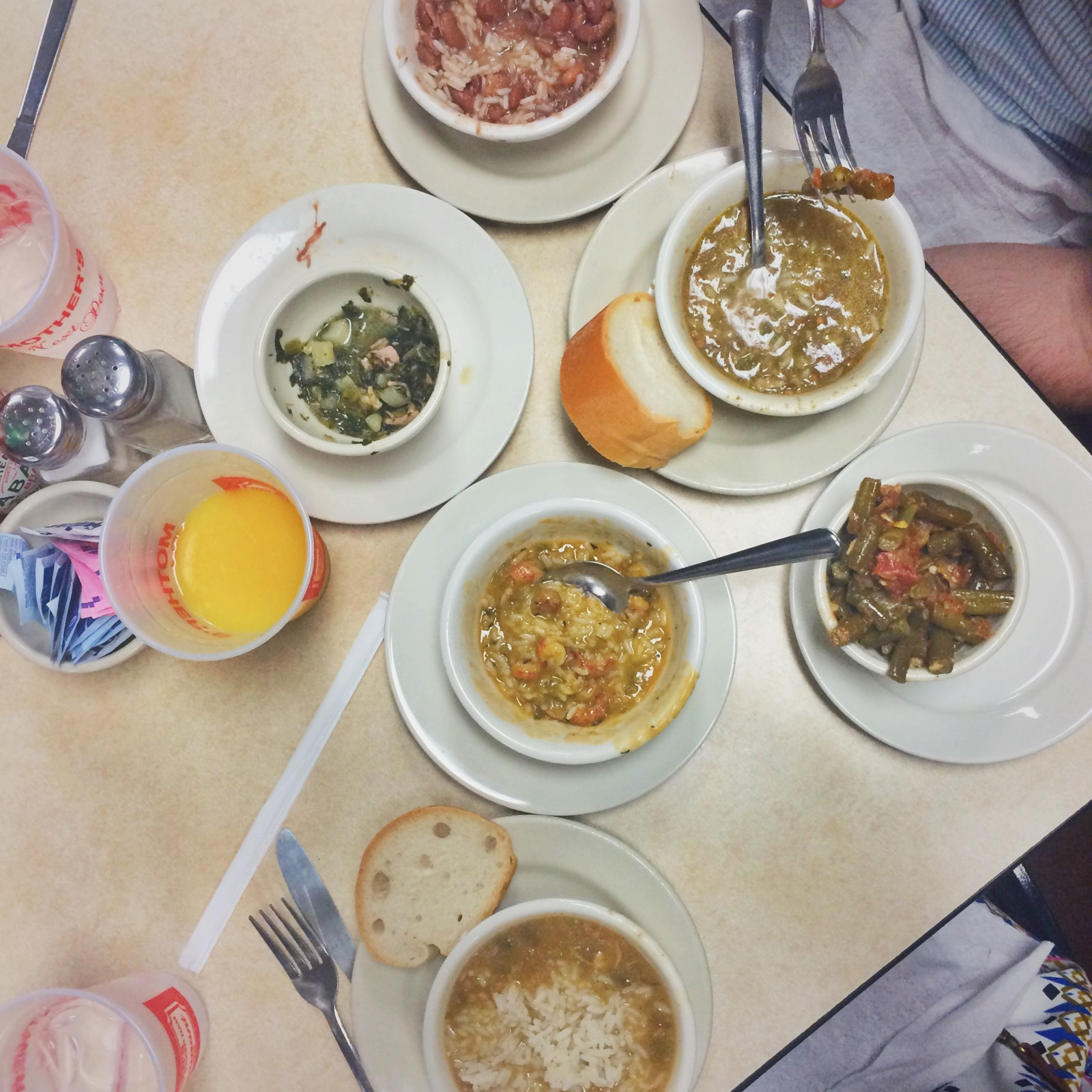 Dining at Mother's. Joe wanted to try them all - Crawfish Etouffee, Chicken & Sausage gumbo, seafood gumbo, red beans and rice and collard greens.