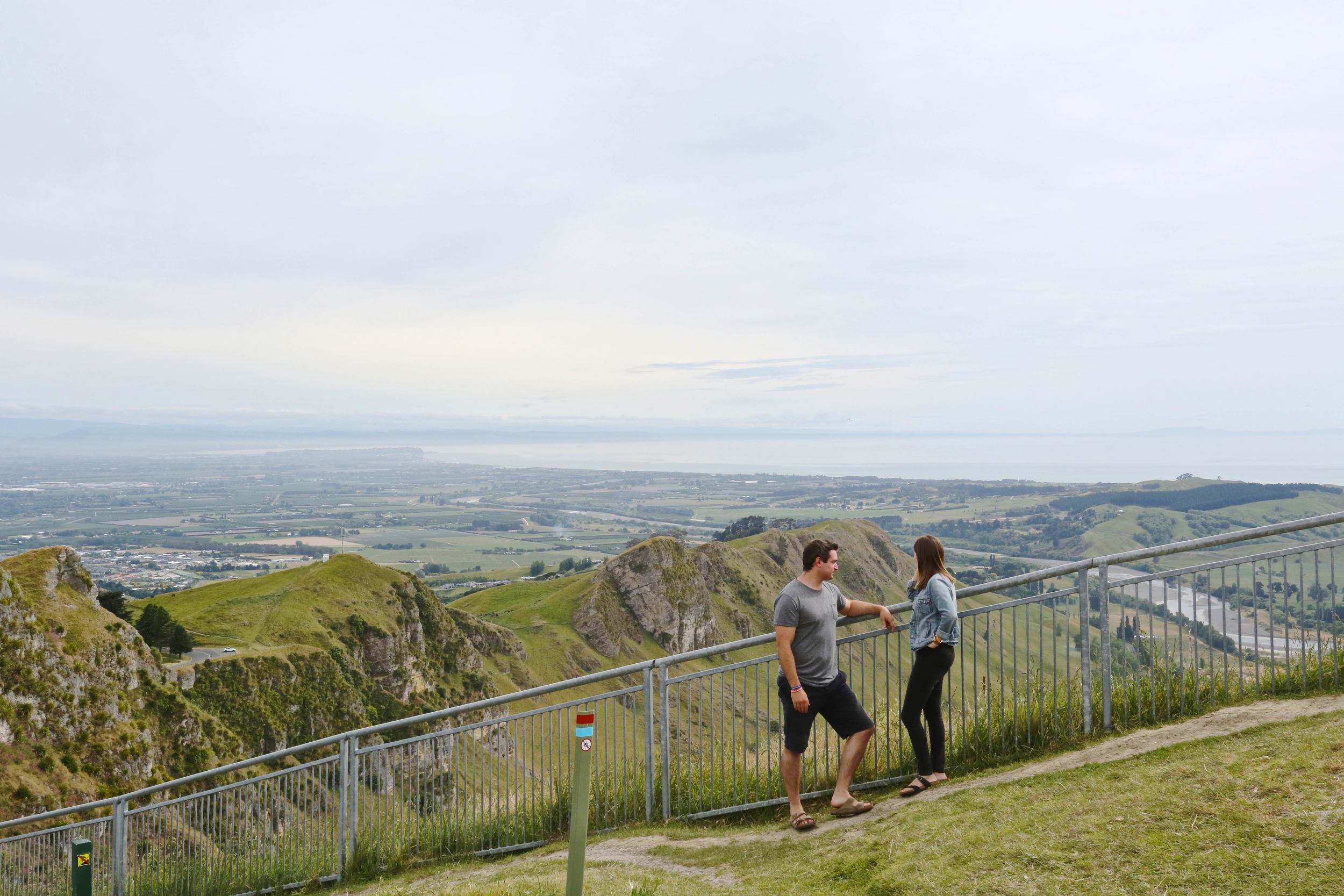 "Te Mata Peak  - This became one of our favorite hiking spots. When it's not so cloudy, the Pacific Ocean is a beautiful turquoise color.  What you didn't get to see: A guy walked up to us while we were filming this 'decision' scene and said, ""Are you guys filming House Hunters International? Is it gonna be house 1, 2 or 3?"" haha!"
