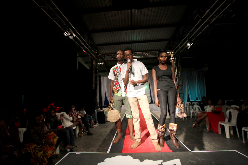 Kez and a couple models wearing his pieces.