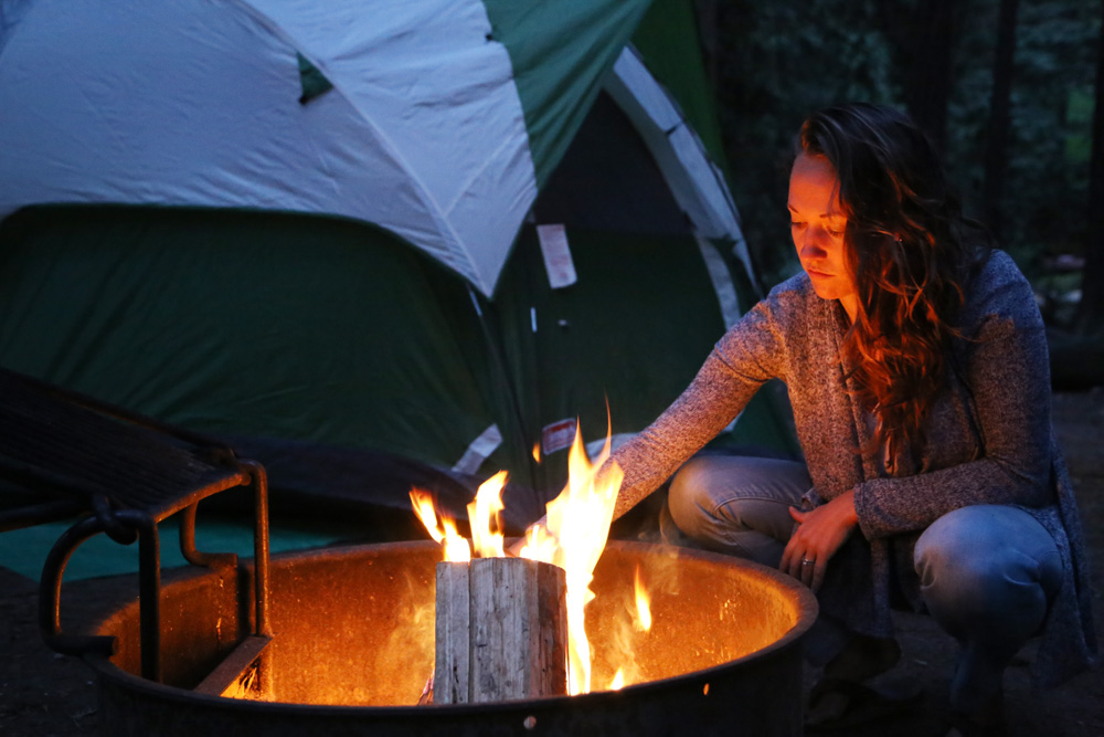 Stoking the fire while camping in Big Sur