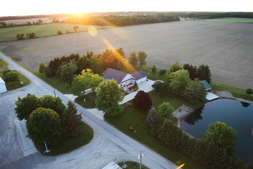A view of home from the top of the grain bins