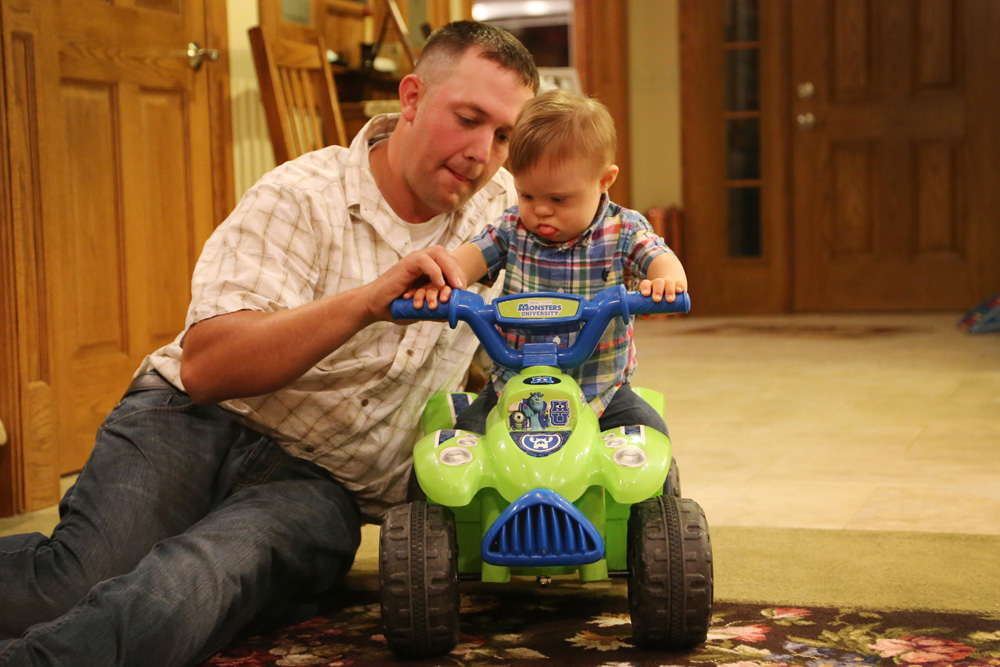 Jake giving Ryan his first 4-wheeler riding lesson