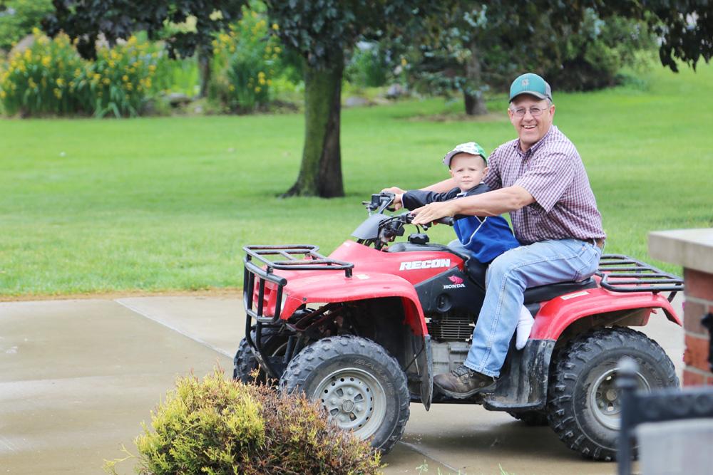 Mason and Dad on a 4-wheeler ride