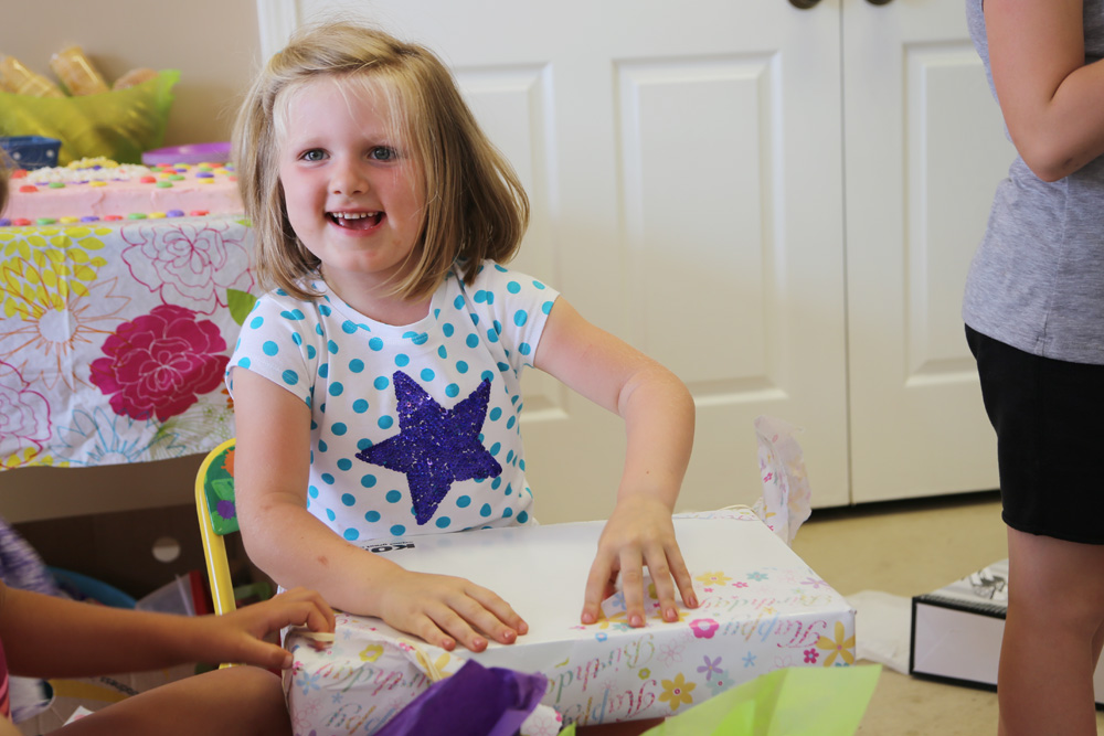 Morgan opening her birthday gifts