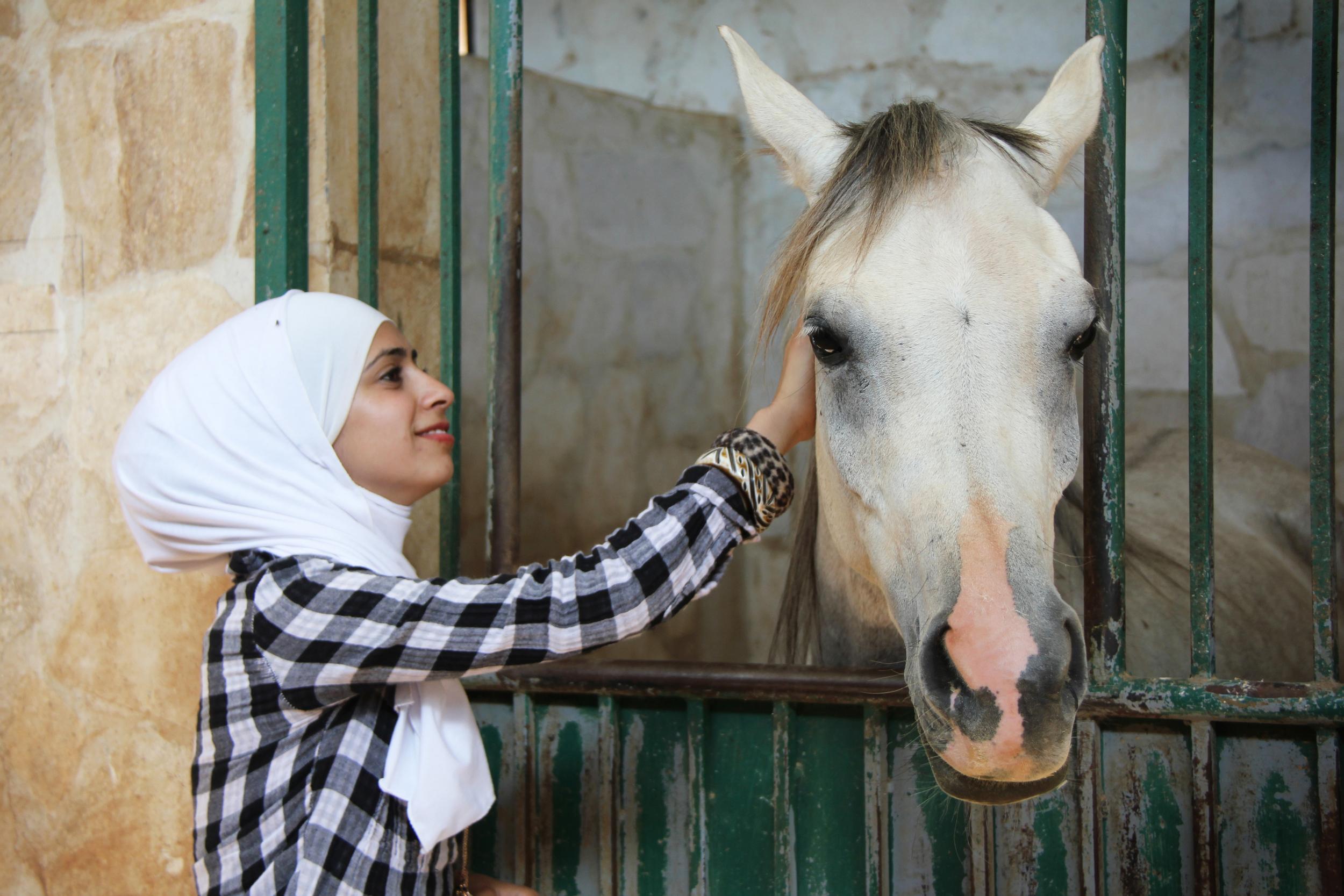19.6.11 Ayah petting the horses in Gilead.JPG