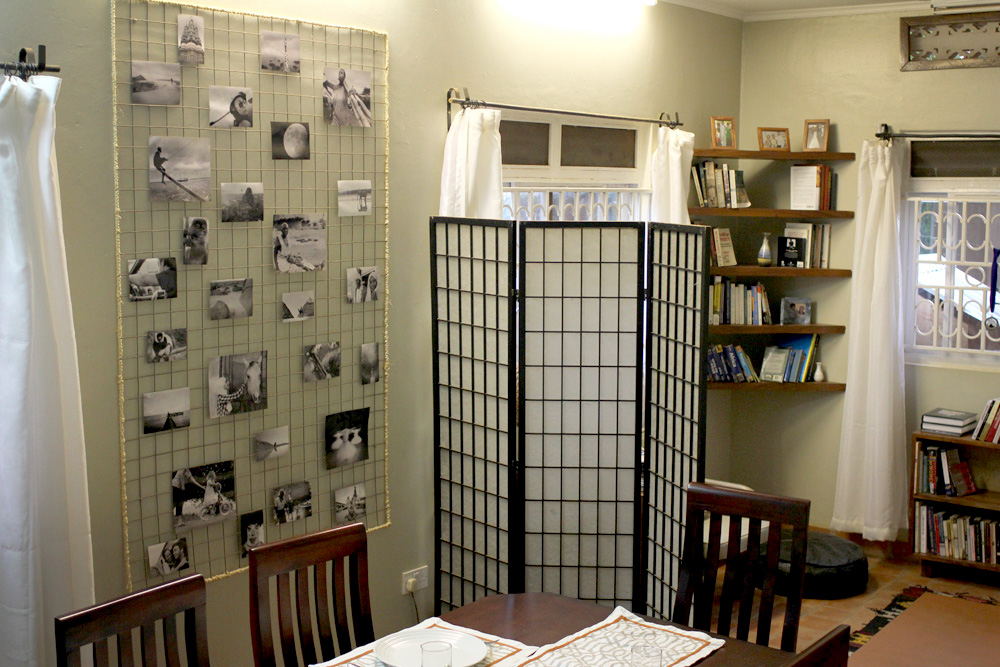 The homemade wire photo board displayed in our dining room