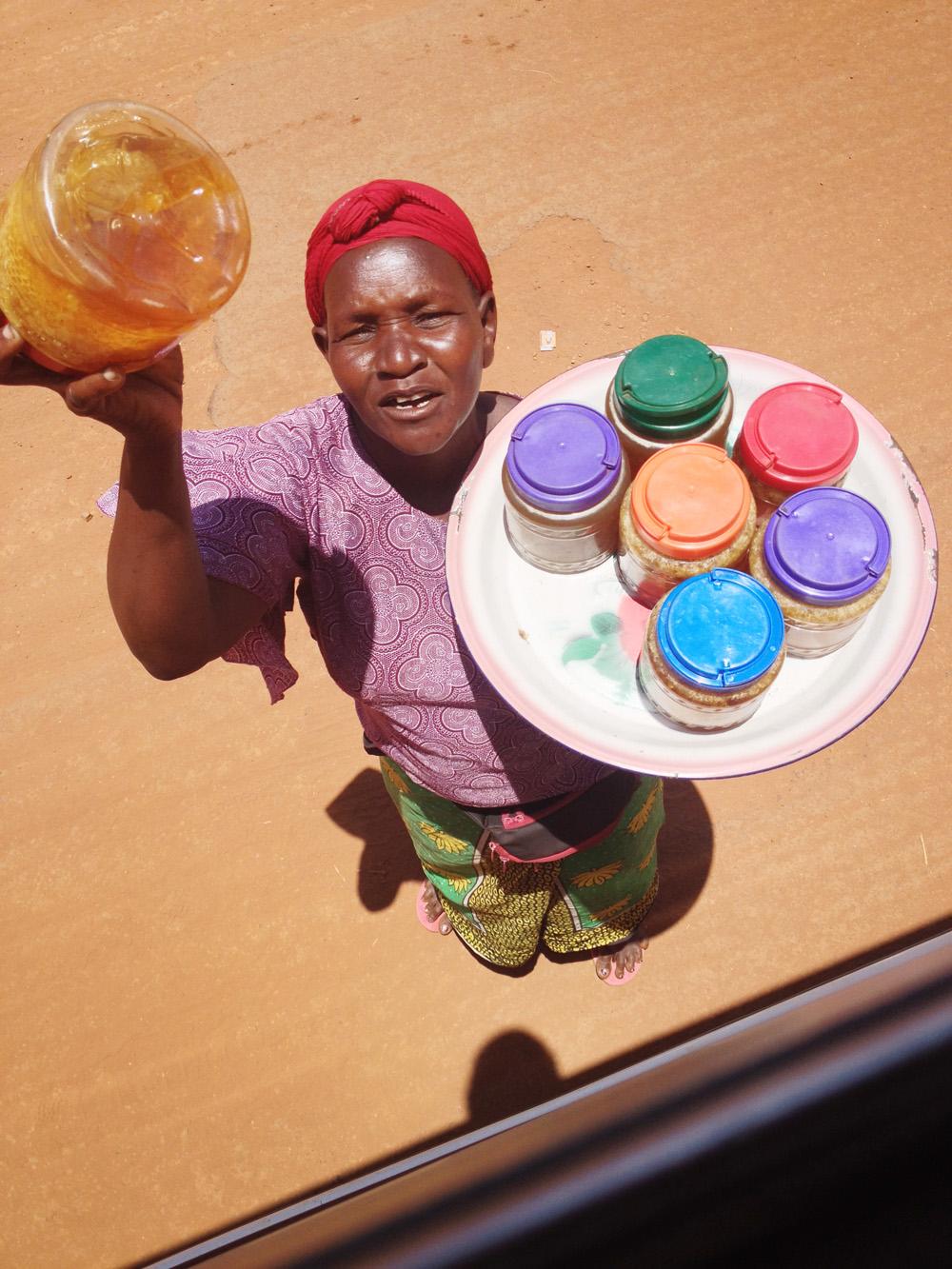 Selling honey in Uganda