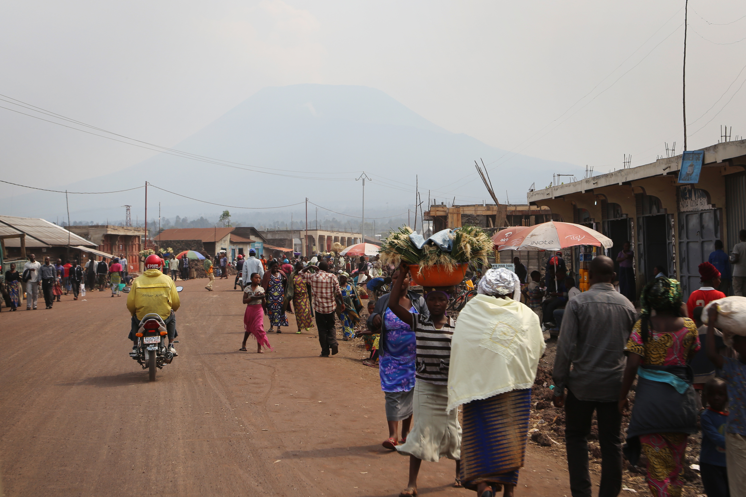 The streets of Goma with Nyarigongo Volcano, looming above the city