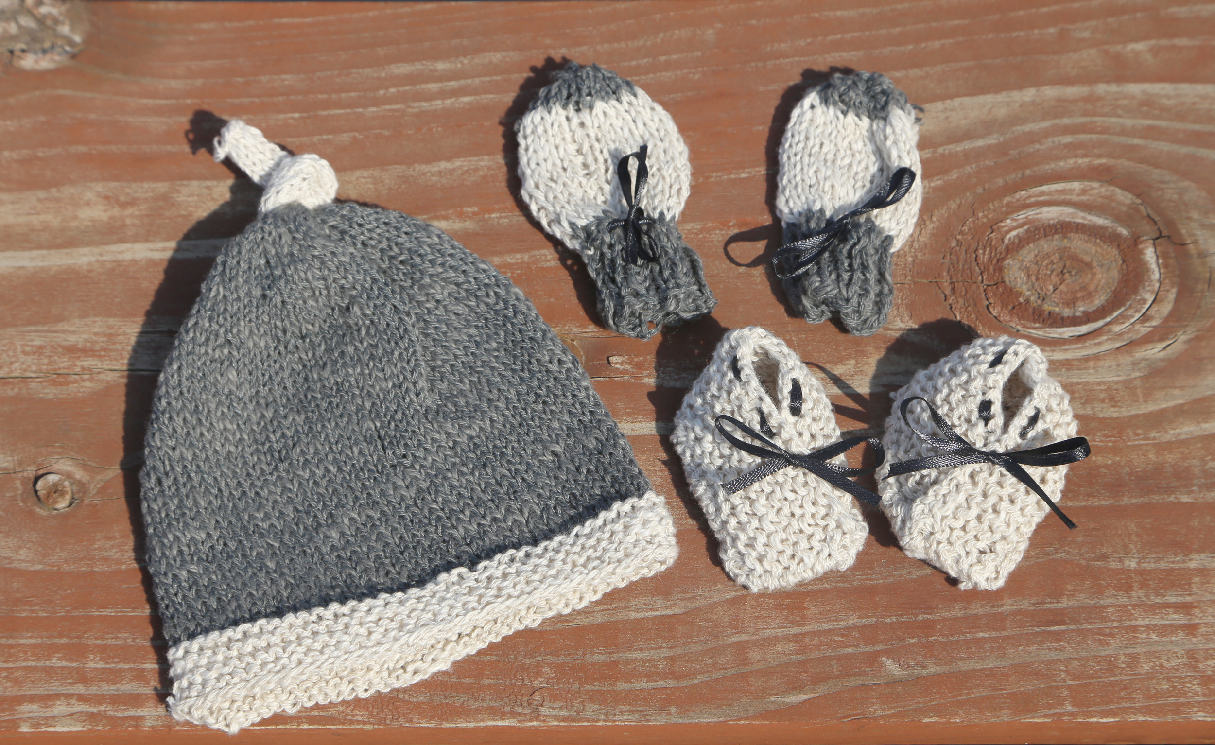 Top knot hat  by Mack and Mabel,  baby mitts  by Spud and Chloe,  bitty baby booties  by Small + Friendly