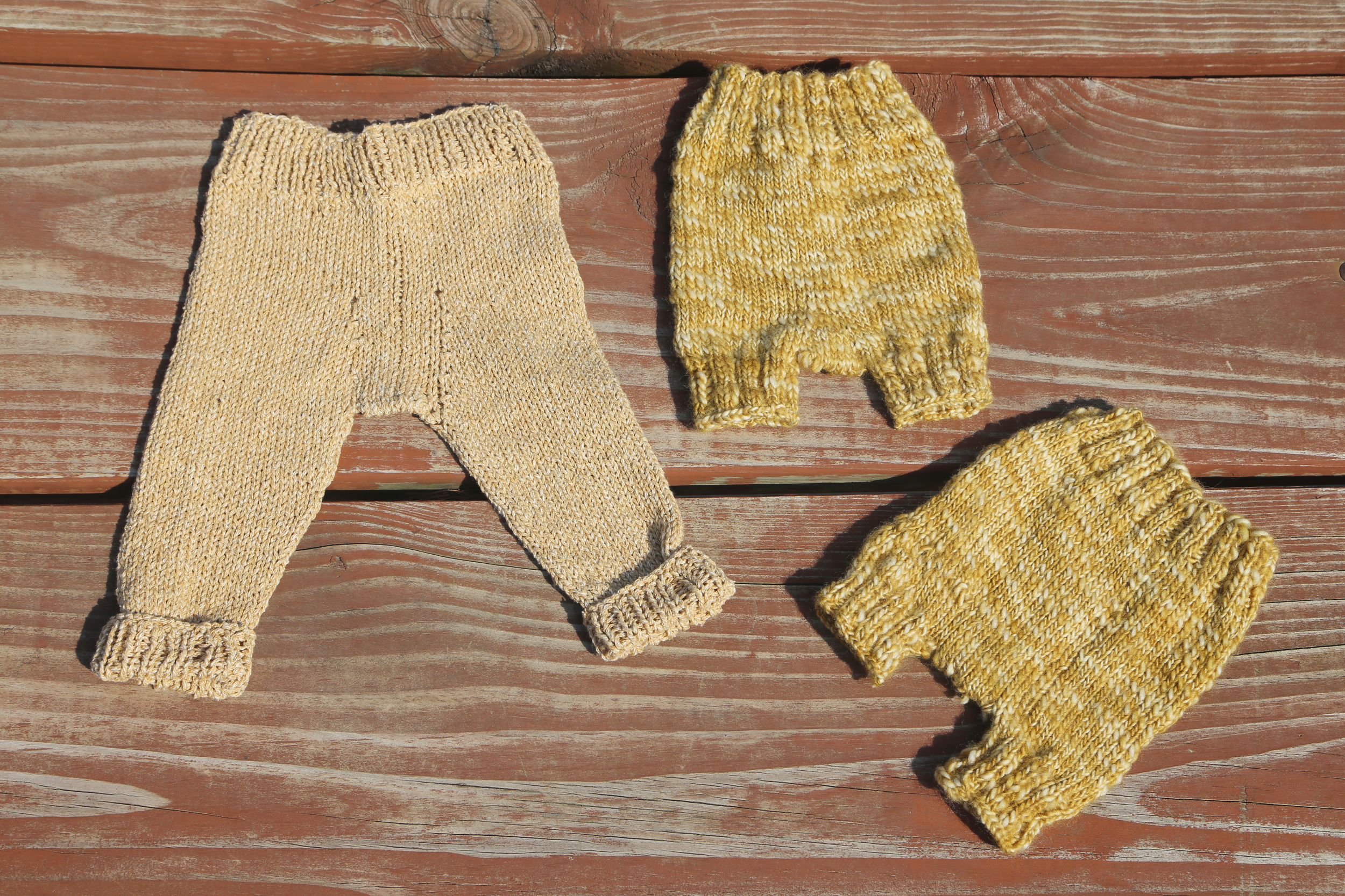 Baby pants  by Pa Avigsidan,  Diaper covers  by Tricksy Knitter