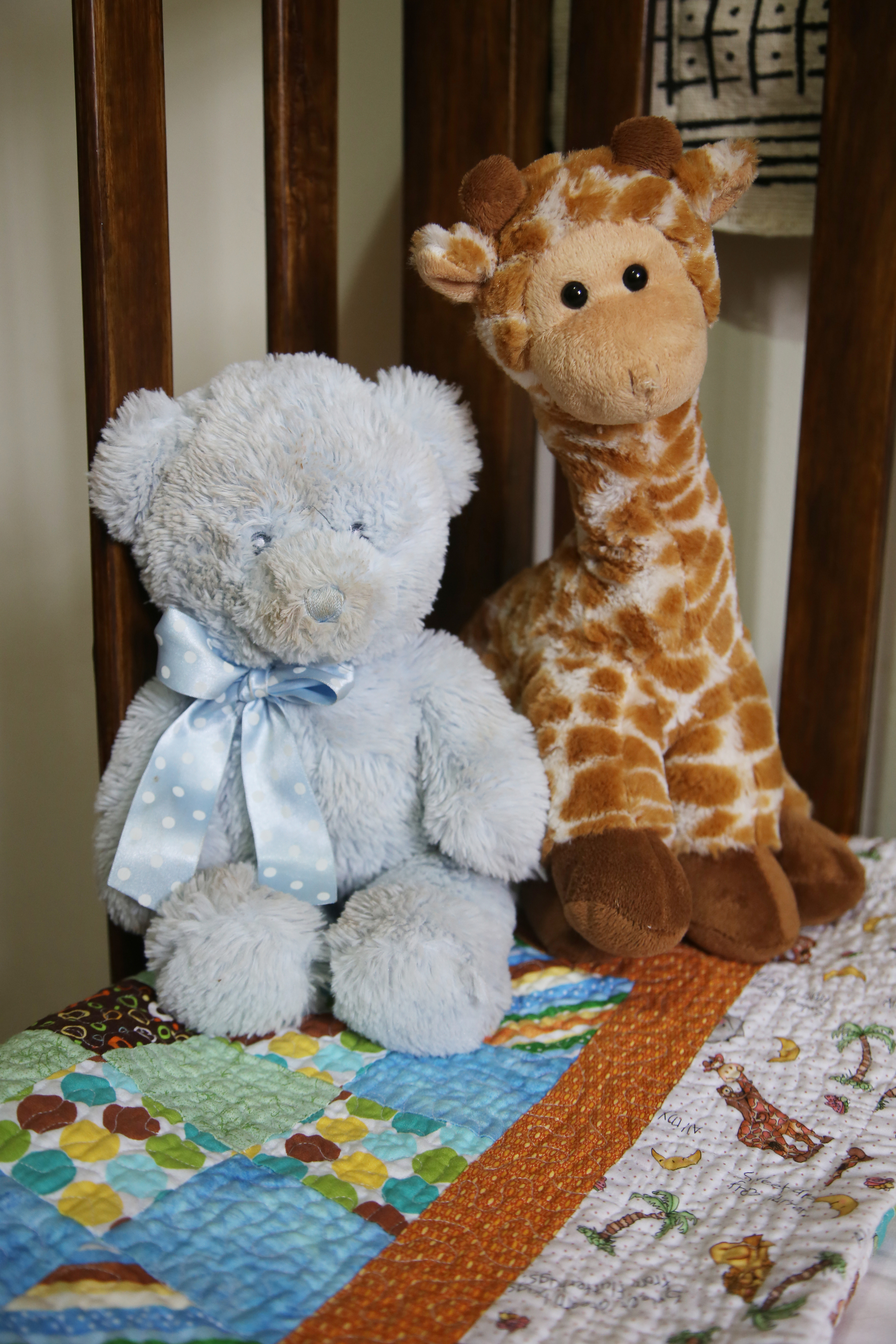 Quilt made by my second cousin.  Stuffed animals gifts from Leo's 2 aunts.