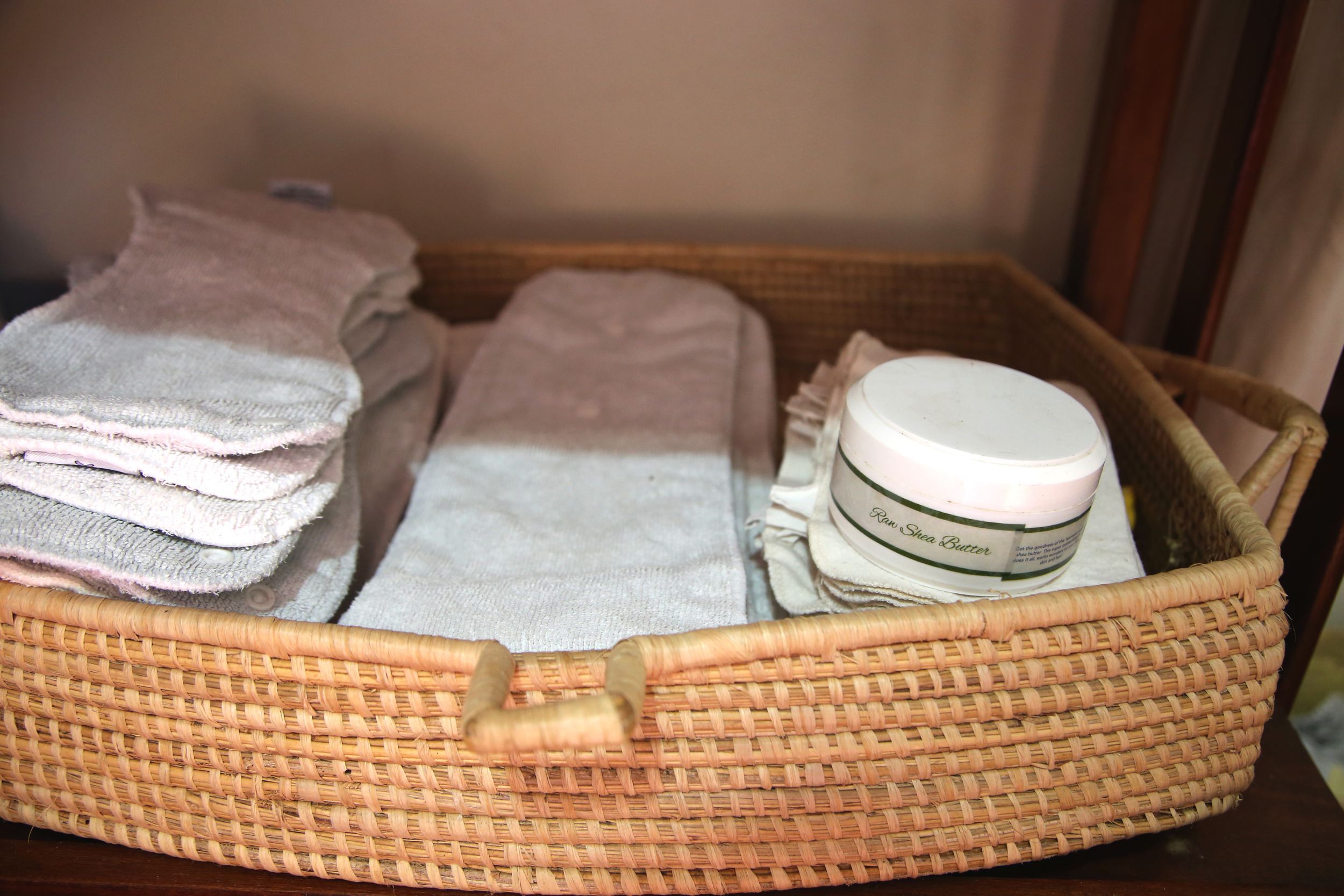 Diaper basket woven in Uganda from palm leaves.  Pure shea butter made in Uganda and available at  Baby Lionheart .