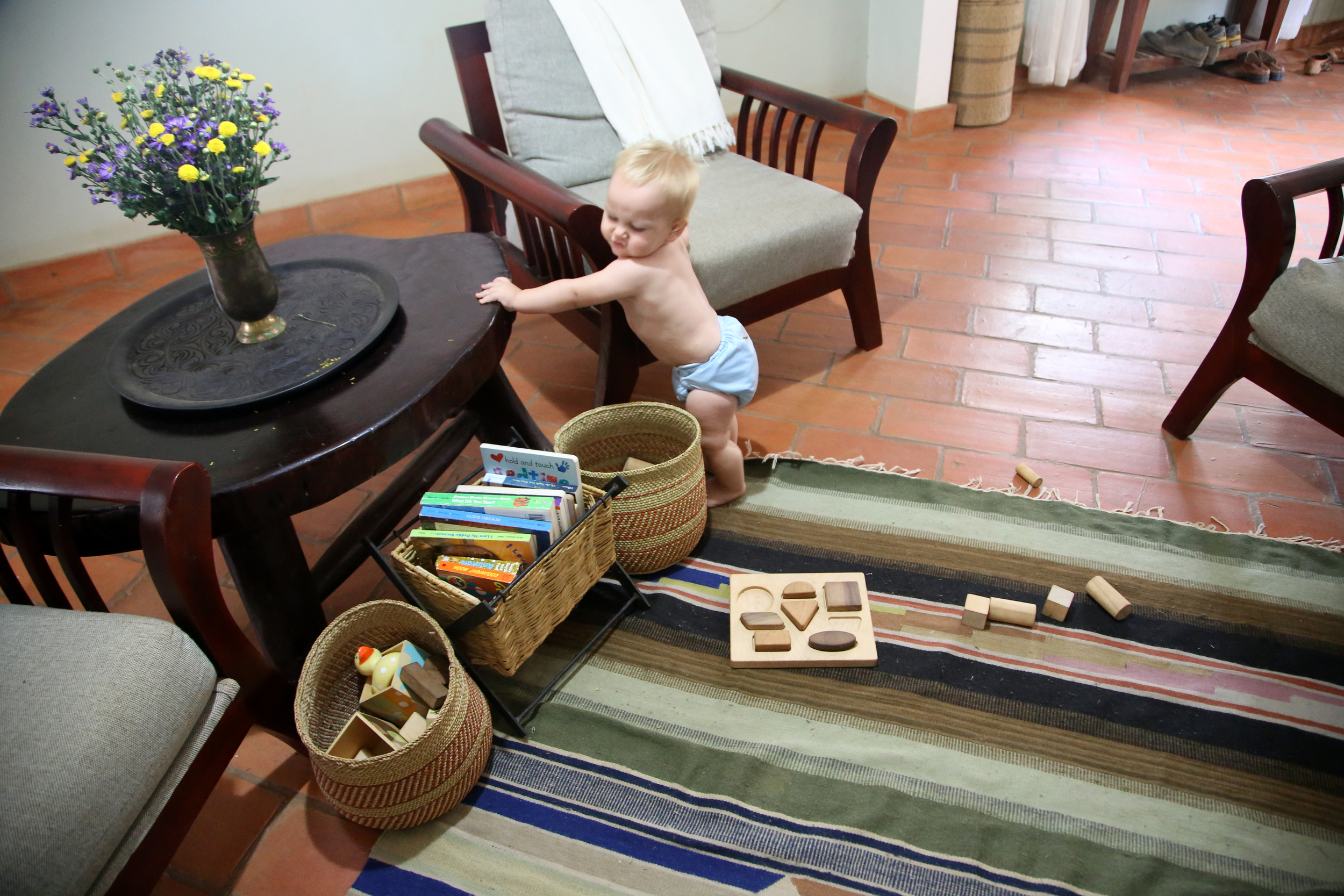 Toy baskets bought locally. Wooden blocks from  Baby Lionheart .  Wooden puzzle from  Manzanita Kids .
