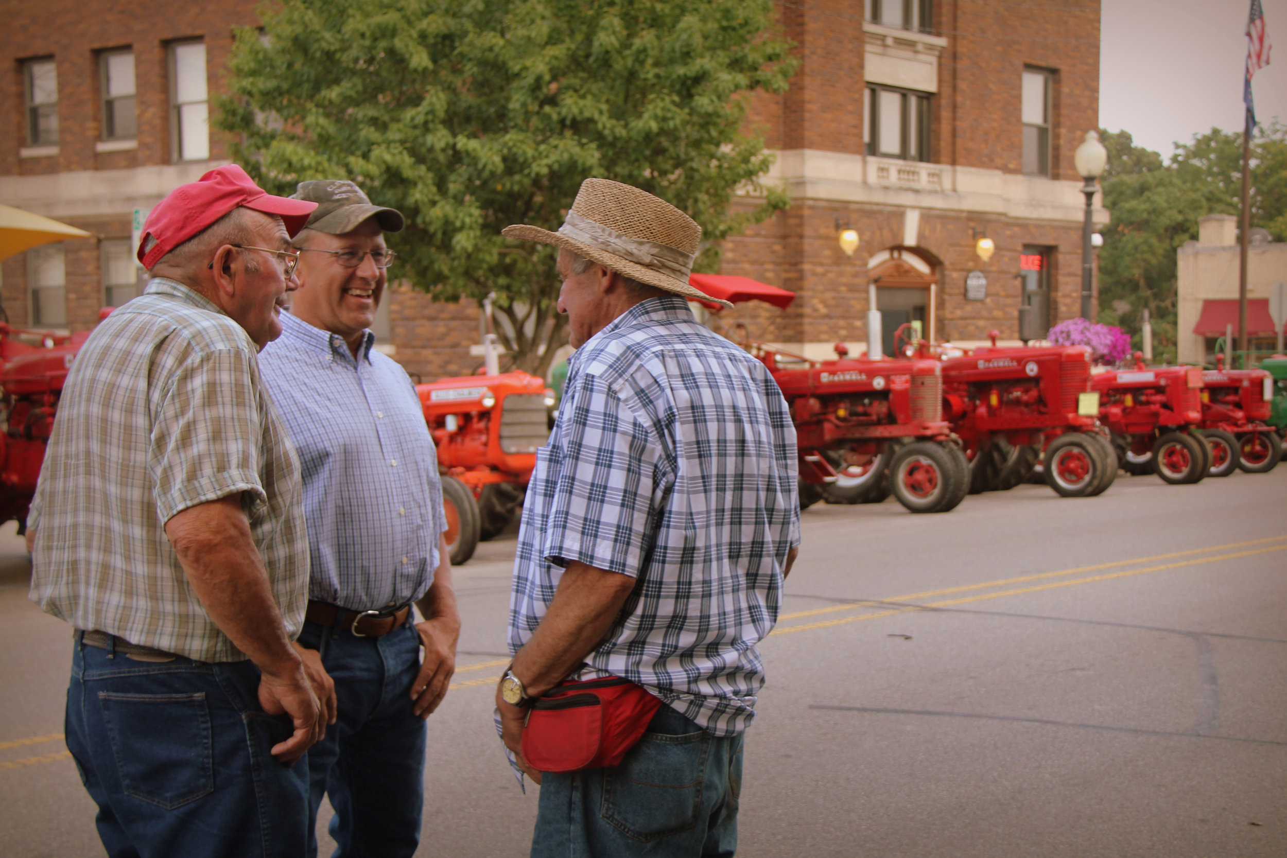 6.7.12 Dad and friends at tractor drive-in.JPG