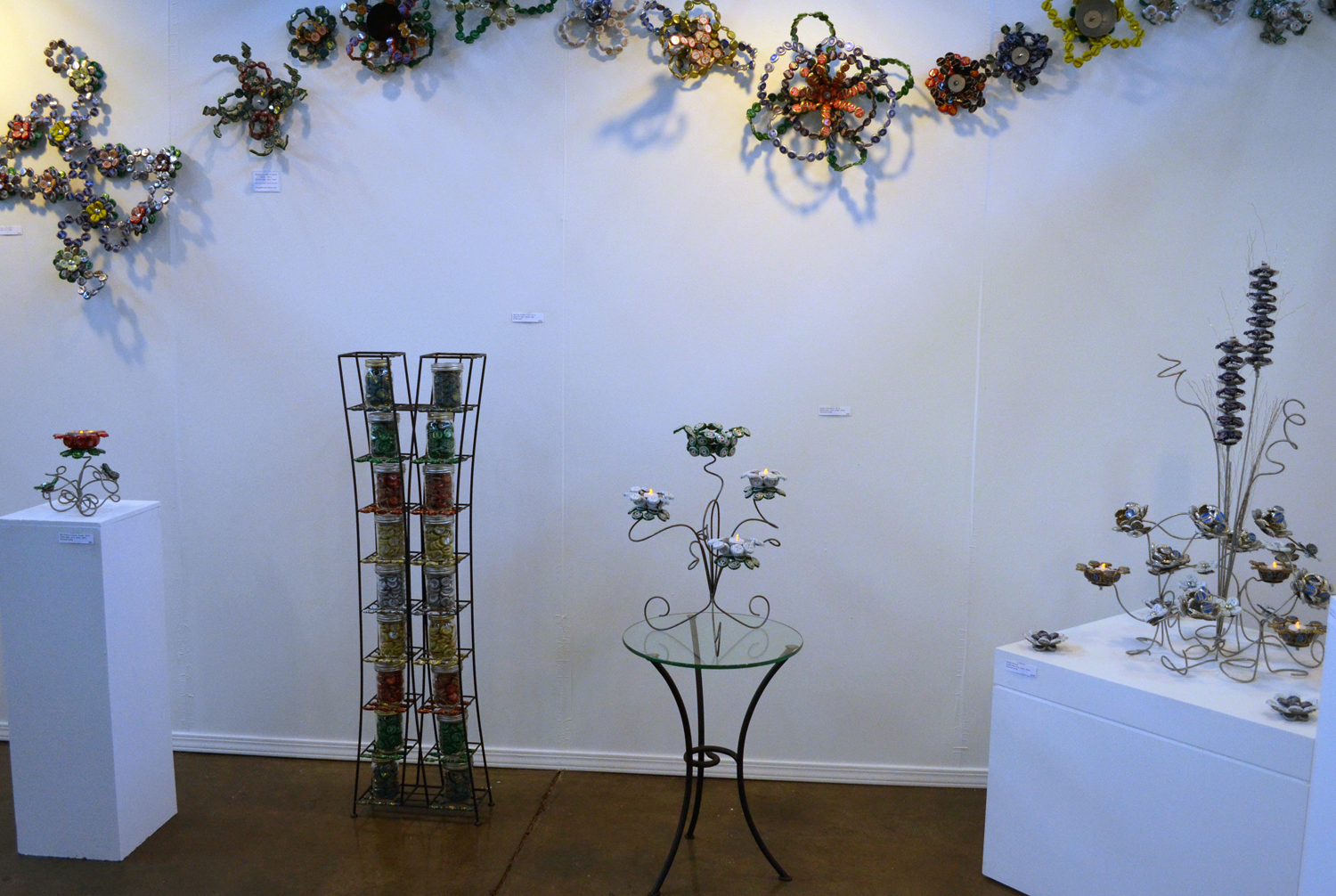 I especially enjoyed playing with new ways to display some of my older bottle cap wall flowers.