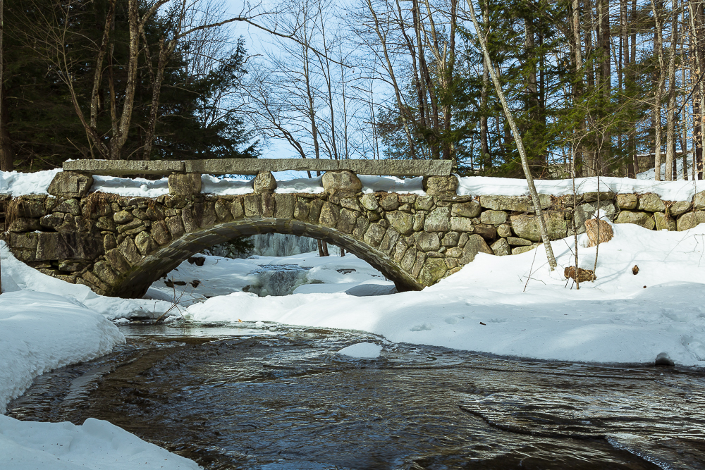 Snow covers one of several historic bridges on the property.  Photo: Norm Rodgrigue