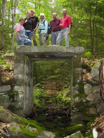 KLT volunteers on the stone bridge which the Great Back Lots Trail passes over.  Photo: Theresa Kerchner