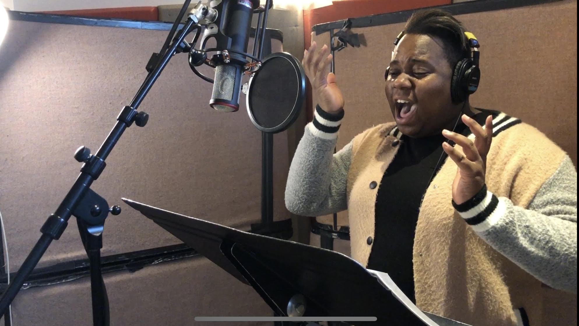 Alex Newell  channeling the stage in the booth.
