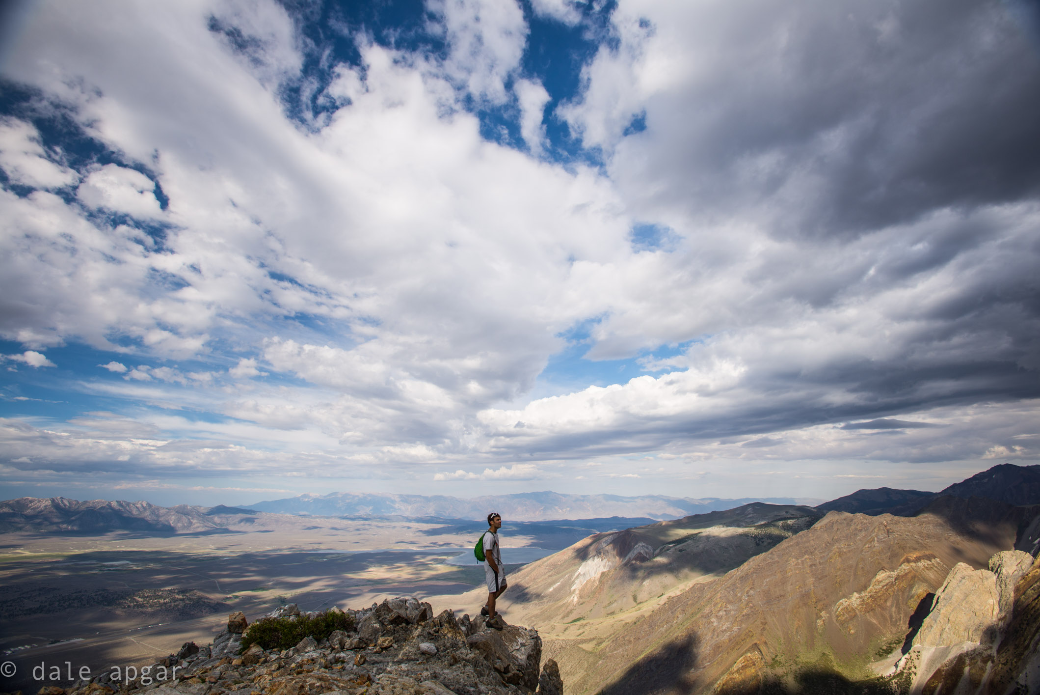 Robb enjoys the rare cloud cover keeping the sky company while descending Laurel Mountain