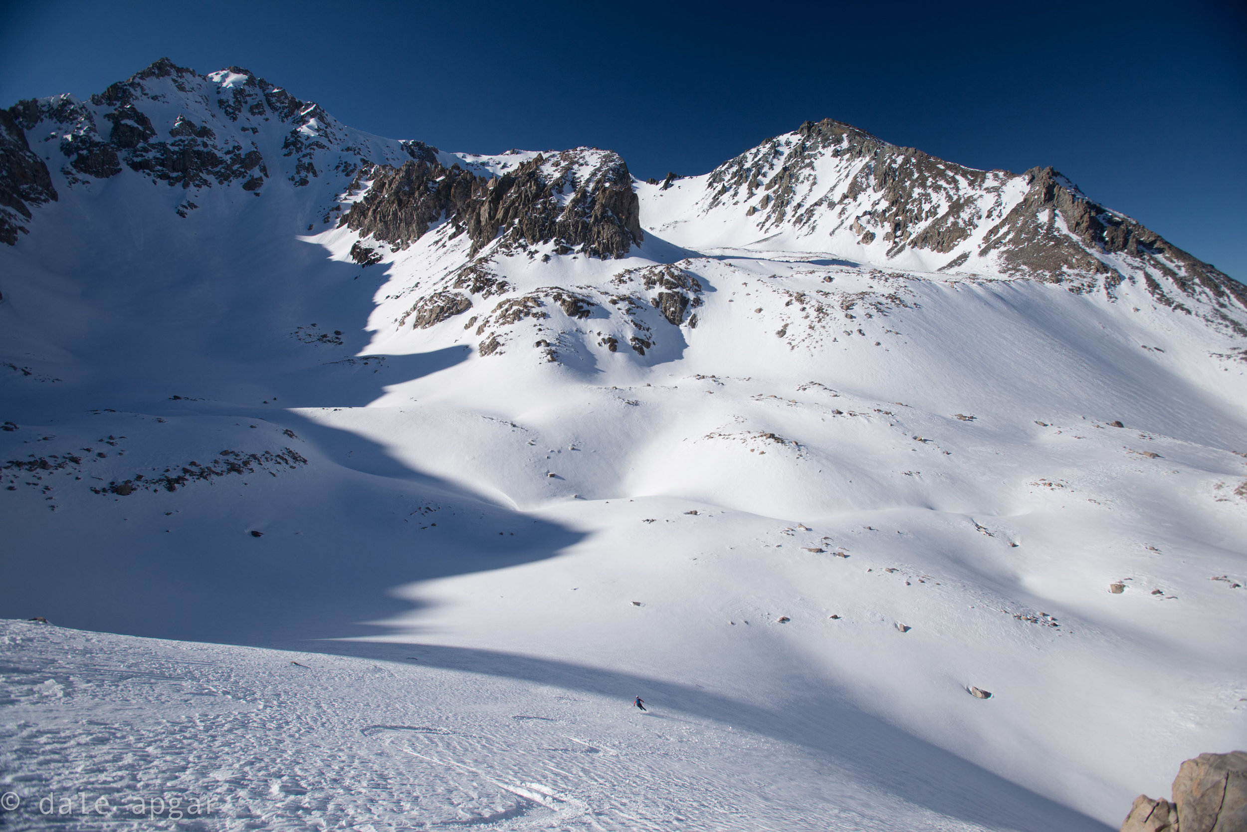 Ben putting his serpentine signature on some seldom-visited powder with Black Peak [l] and Mt. Mary Austin [r] looming behind