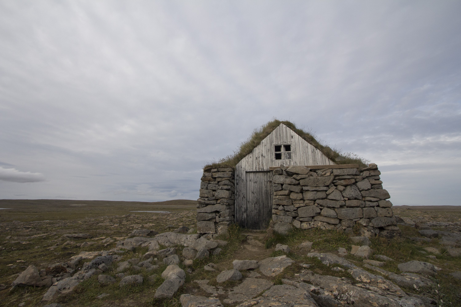 An abandoned turf house on the drive out of the Westfjords.