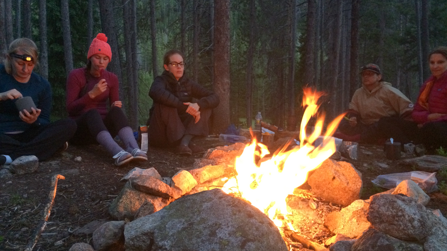 Everyone collected wood and I taught them how to make a proper fire. Rachael (the one in that cute beanie) did an awesome job of stoking the fire and keeping it ablaze. We sat here to have dinner and relax after day one.